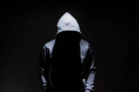 89920306-silhouette-of-man-in-the-hood-dark-mysterious-man-hoodie-murderer-hacker-anonymus-on-the-black-backg